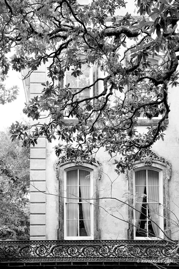 OLD BUIDLING ORNAMENTAL WINDOWS HISTORIC SAVANNAH GEORGIA BLACK AND WHITE VERTICAL
