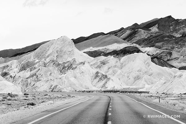 ROAD AND BADLANDS NEAR ZABRISKIE POINT DEATH VALLEY NATIONAL PARK CALIFORNIA BLACK AND WHITE