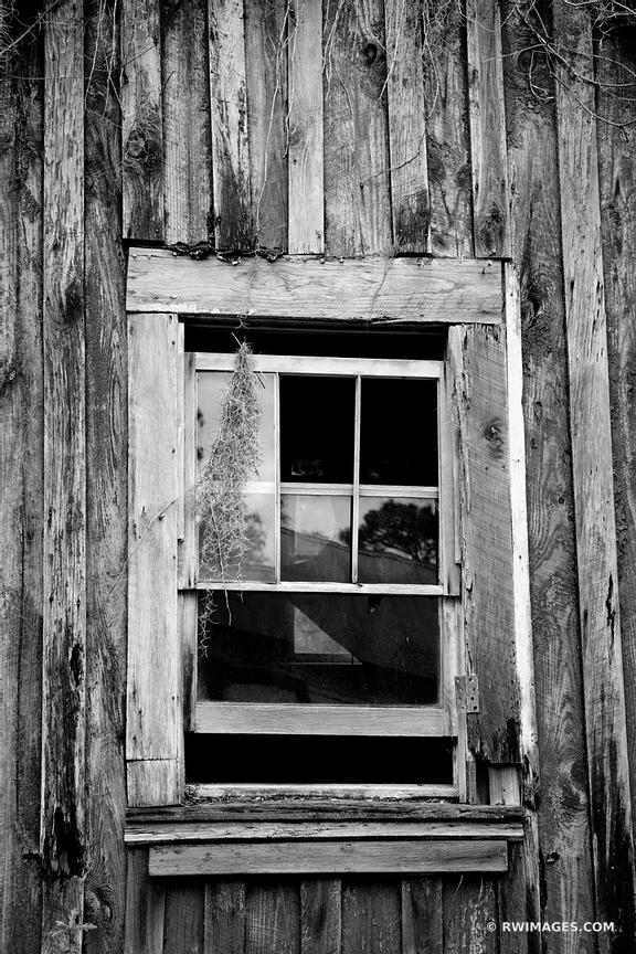 BROKEN WINDOW ABANDONED HOUSE THE SETTLEMENT CUMBERLAND ISLAND GEORGIA BLACK AND WHITE