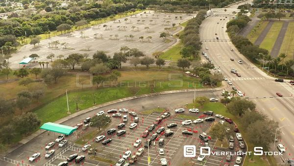 Pull Out Reveal Crowded Parking Lot Covid 19 Coronavirus Vaccine and Testing Sites Miami Florida