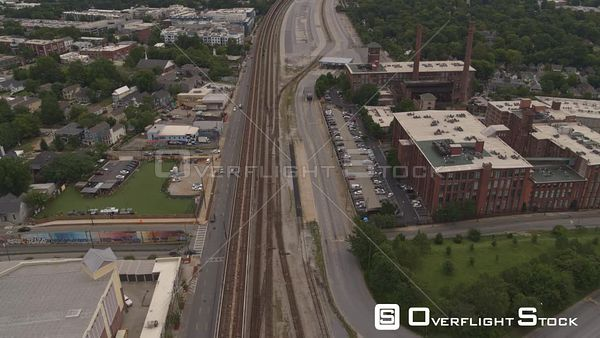 Atlanta Descending overtop train tracks near cotton mill lofts moving very low over Hulsey Yard toward Reynoldstown