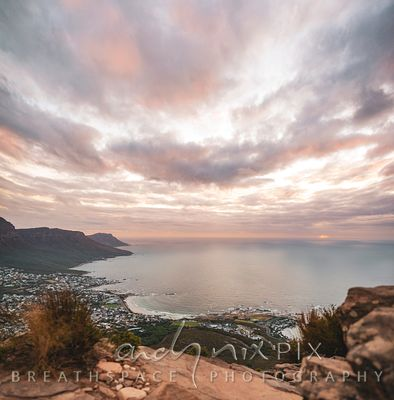 Elevated view of Camps Bay and the Twelve Apostles from Lion's Head, golden yellow sunset light