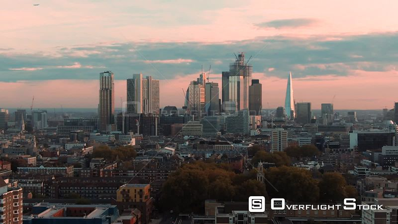 Aerial dolly view of the skyline of the city and central London from the North at sunset