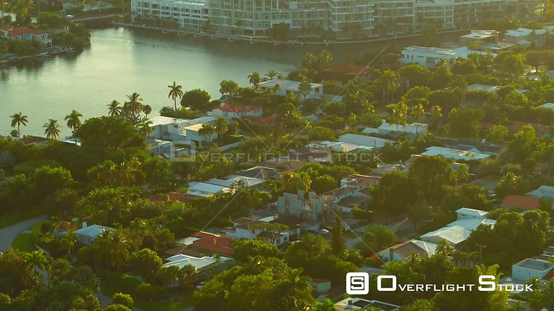 Beautiful sunny day over luxury mansion neighborhood Miami Beach shot with aerial drone 4k
