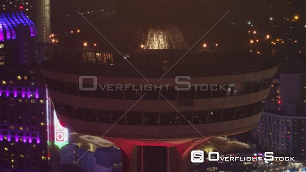 Niagara Falls Ontario Panning Skylon Tower detail to reverse cityscape view at night