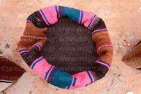 Black quinoa grains in a woven wool bag, Bolivia