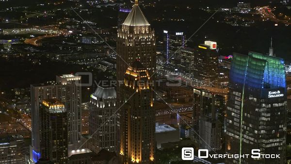 Atlanta Low panning nighttime cityscape birdseye sweeping from midtown to downtown with Atlantic Station in backdrop