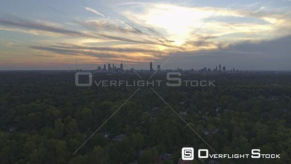 Atlanta Flying over Druid Hills Golf Course in reverse looking at skyscraper skyline with sunset