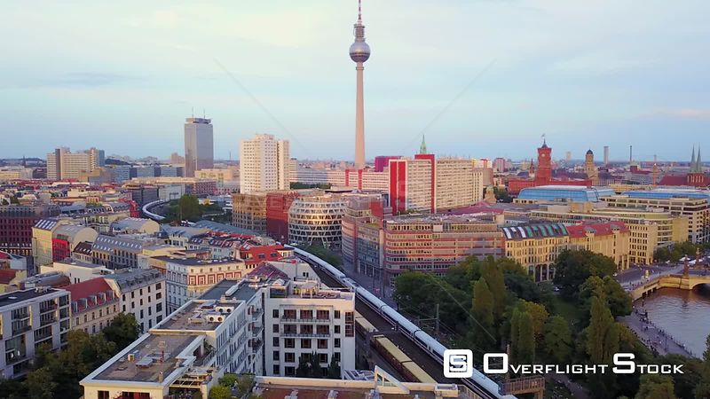 Germany Berlin Aerial Flying low around Monbijou Park area with cityscape views sunset