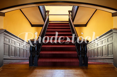 Red Carpeted Stairway And Yellow Walls at To Kalon Club