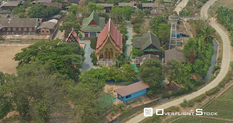 Thung Pi Thailand Aerial Panning birdseye of village temple and hillside