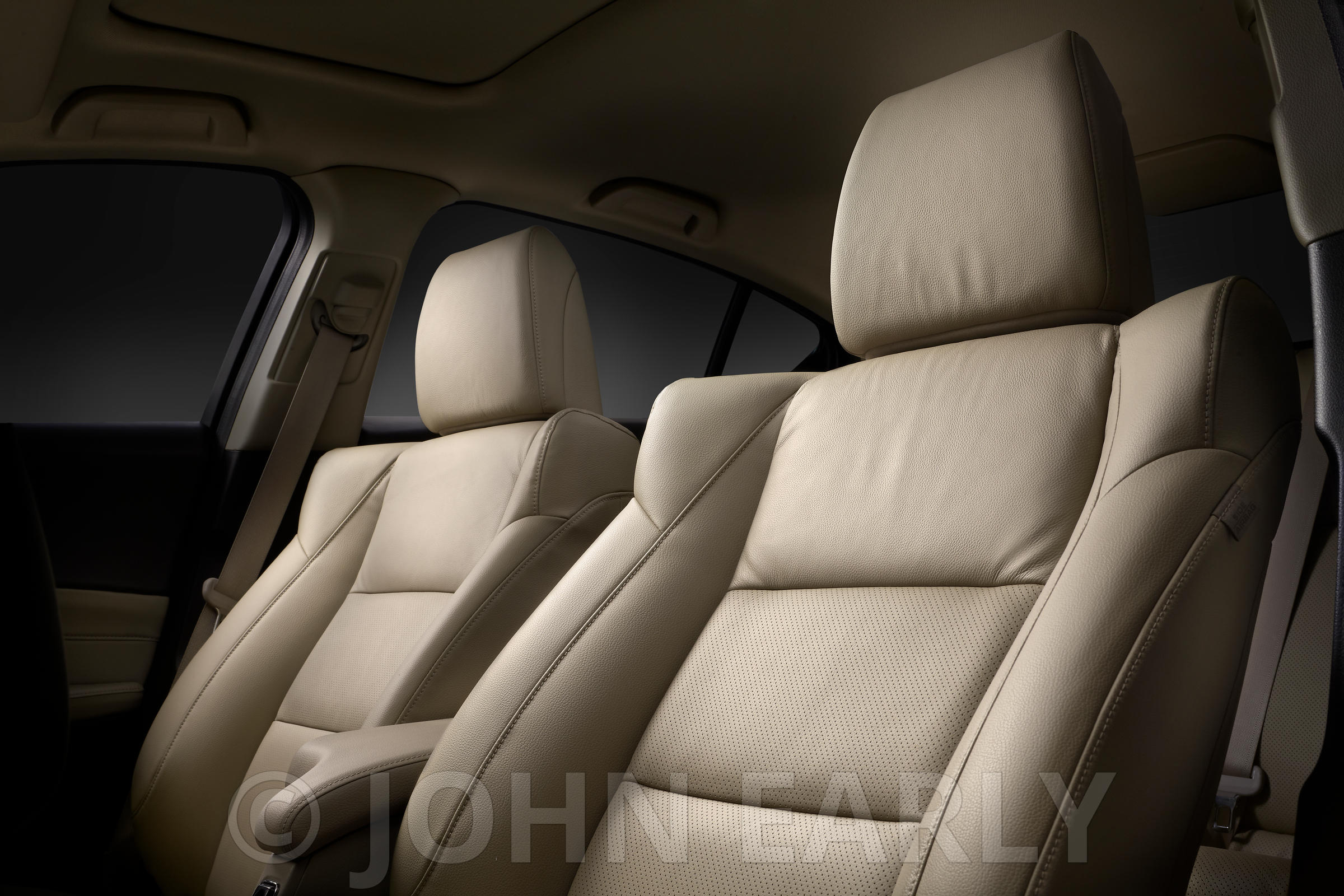 Moody Low Angle View of Tan Leather Front Seats In A Car