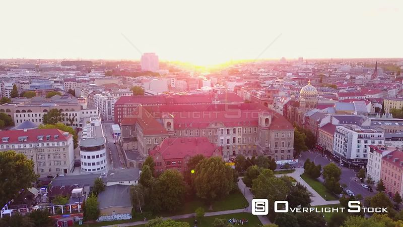 Germany Berlin Aerial Flying low backwards over Monbijou Park area cityscape sunset