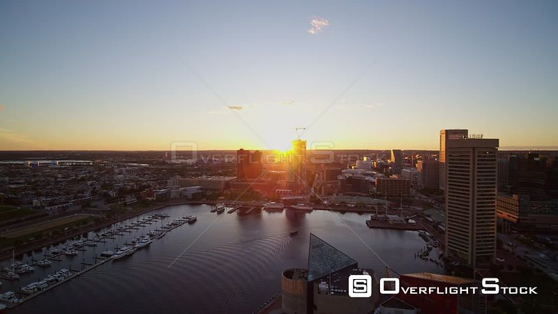 Baltimore Maryland Aerial Sunset harbor cityscape flying over water