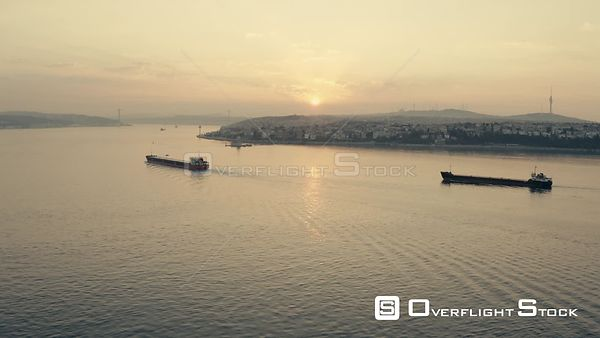 Ships crossing Bosphorus and Istanbul's Asian side at morning golden hour Turkey