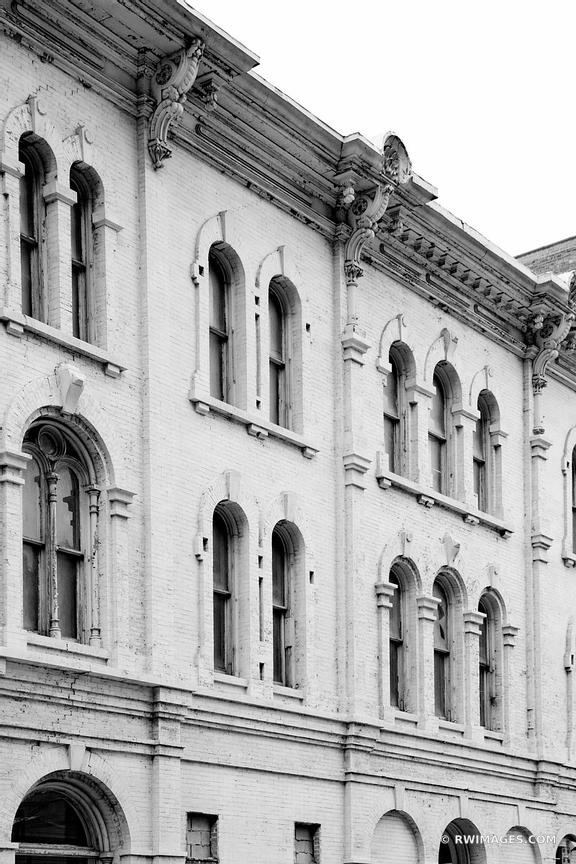 OLD BUILDING FACADE HISTORIC ARCHITECTURE DOWNTOWN MILWAUKEE WISCONSIN BLACK AND WHITE VERTICAL