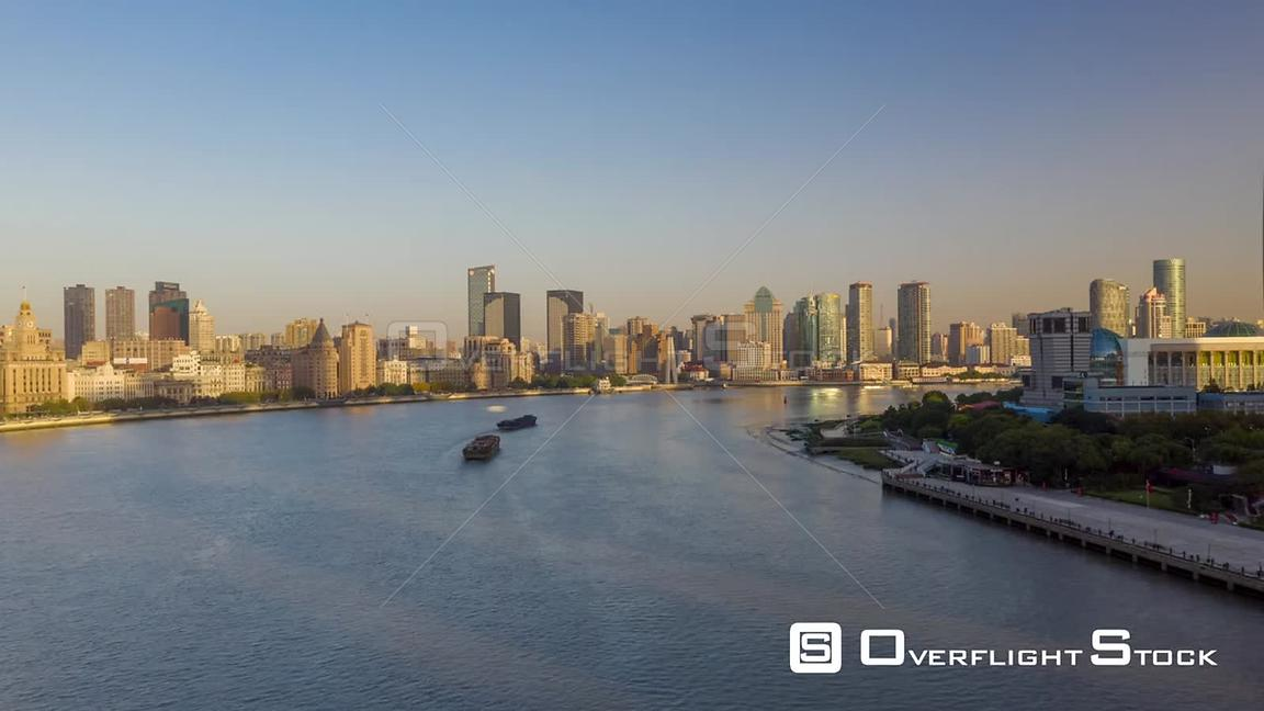 China Shanghai Aerial Hyperlapse flying low over Huangpu river with boats