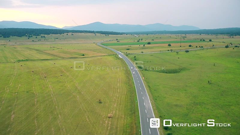 Landscape of countryside, cars running on the road in Bosnia and Herzegovina