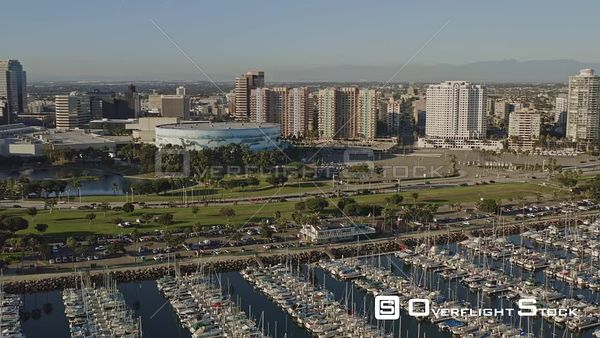 Long Beach CA Rotating low over sailboat marina and around astronaut island with cityscape views