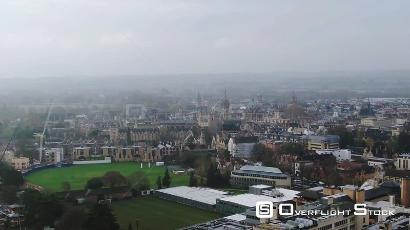 Aerial dolly view of the center of the town of Oxford in a foggy day. United Kingdom