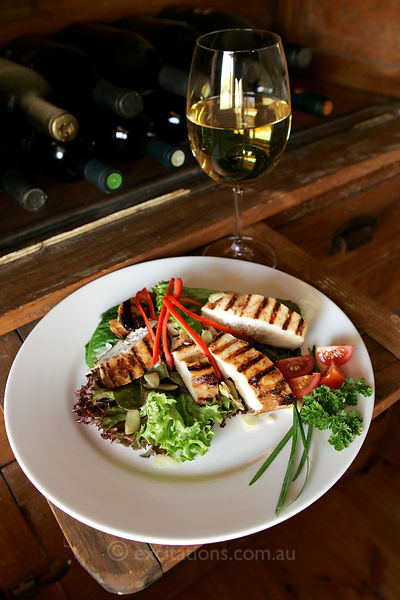 Grilled chicken salad and white wine.