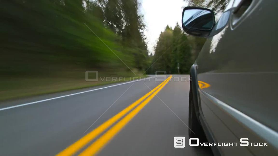 Time lapse clip of driving on windy road with camera attached to side of car.