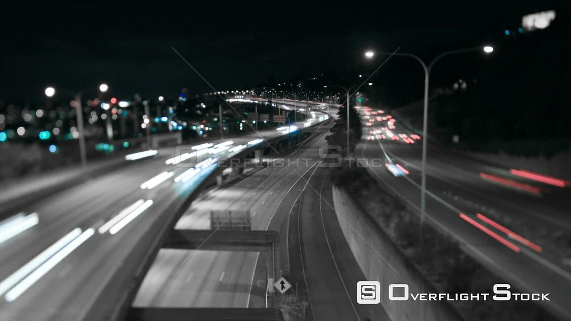 Seattle Washington State USA Seattle I5 traffic time lapse at night using a tilt shit lens and desaturating the yellows and o...