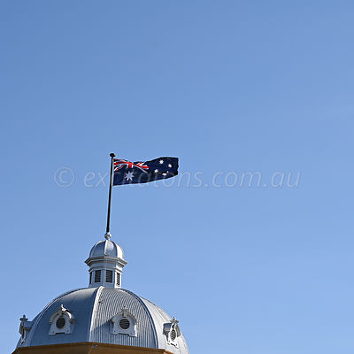 Australian Flag flying on building.