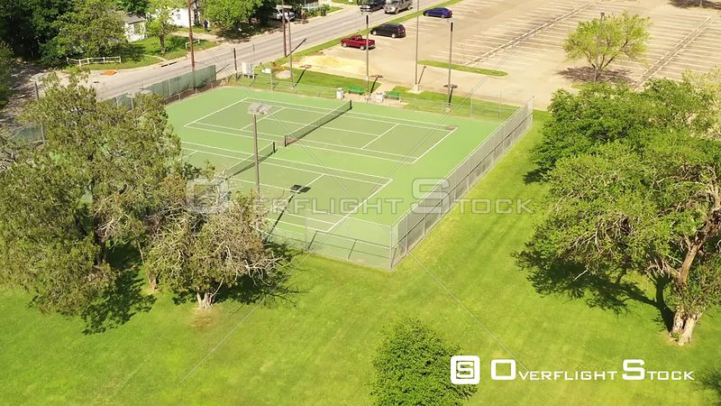 Empty Tennis Courts, Parking Lot and Playground in a City Park, Bryan, Texas, USA