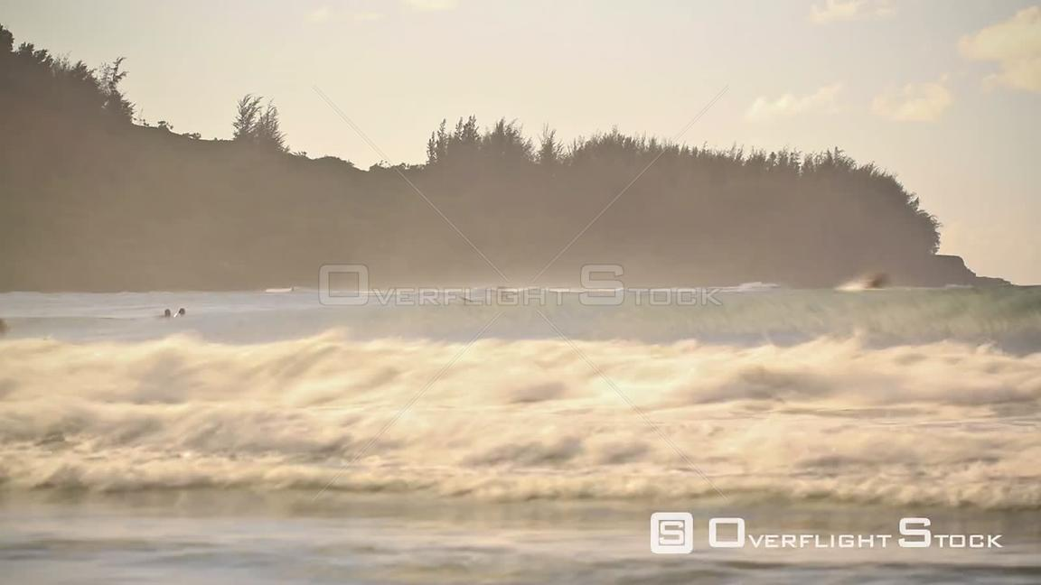 Beach time lapse clip of large waves and surfers. Hawaii