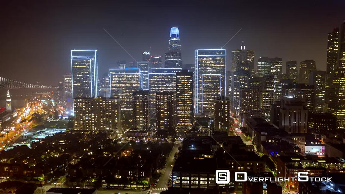 San Francisco Aerial Hyperlapse cityscape at night moving away from Financial District toward Telegraph Hill to Bay