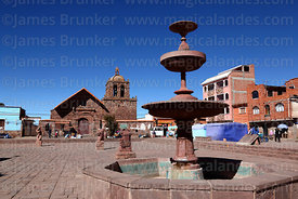 Fountain in main square and San Pedro church, Tiwanaku, La Paz Department, Bolivia