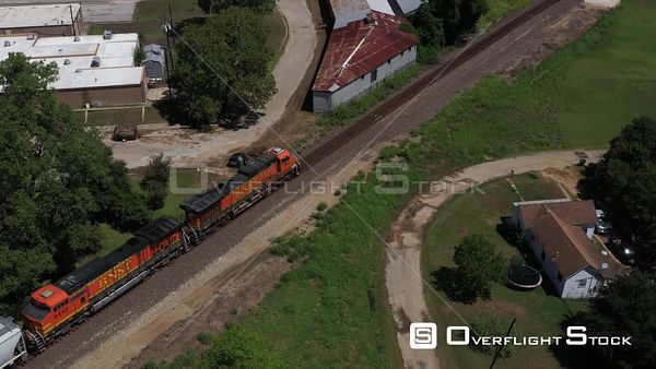 Freight Train Moving Through a Small Town, Cameron, Texas, USA