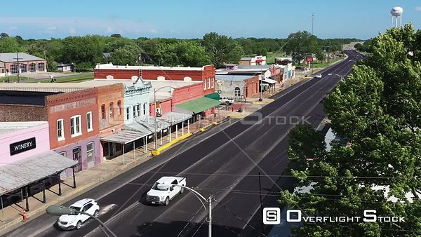 Highway Traffic Passing Old Storefronts and Retail Shops, Calvert, Texas, USA