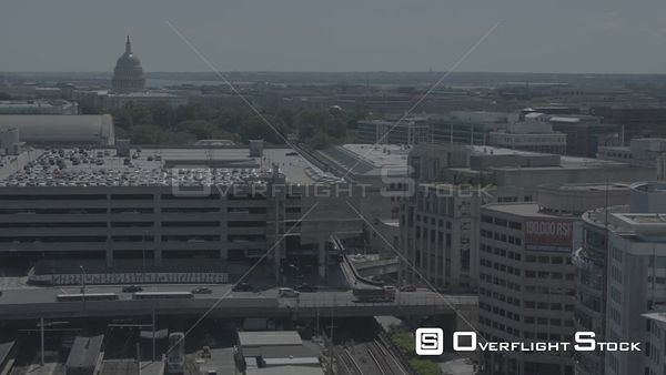 Medium-speed Pan With Tilt from Buildings to the US Capitol Washington DC Drone Aerial View