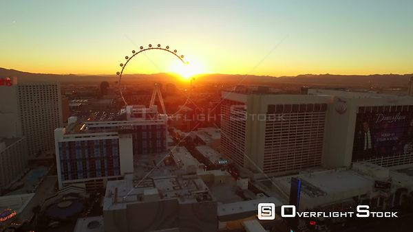 Low flying aerial over high roller ferris wheel and strip Las Vegas Nevada