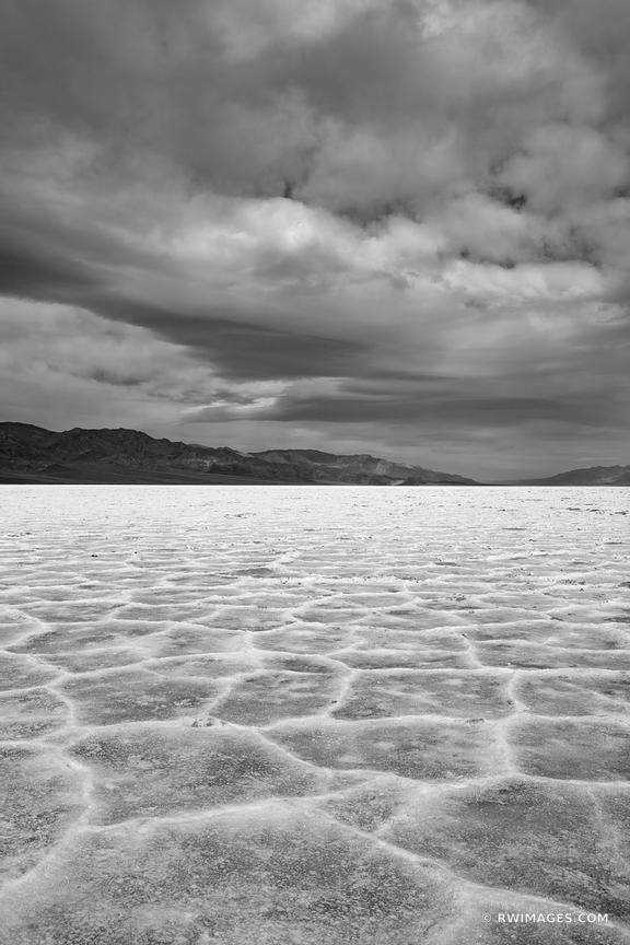 SALT FLATS BADWATER BASIN DEATH VALLEY CALIFORNIA BLACK AND WHITE VERTICAL