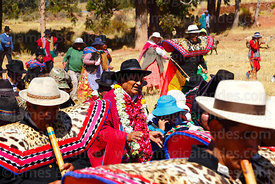 Quena quena musicians accompany Bolivian president Evo Morales Ayma (centre) as he leads an International Hike along a sectio...