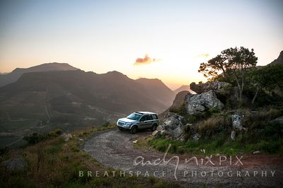Landrover on mountain track at sunset
