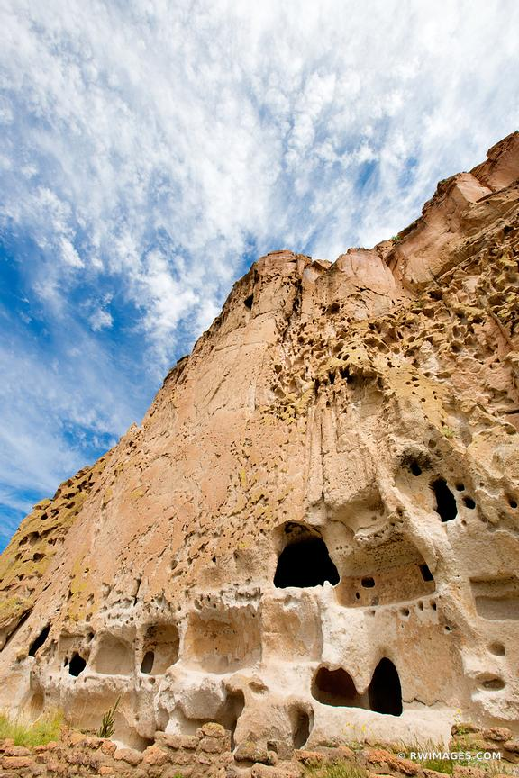 ANCIENT NATIVE AMERICAN ANCESTRAL PUEBLOAN CLIFF DWELLINGS BANDELIER NATIONAL MONUMENT NEW MEXICO VERTICAL COLOR