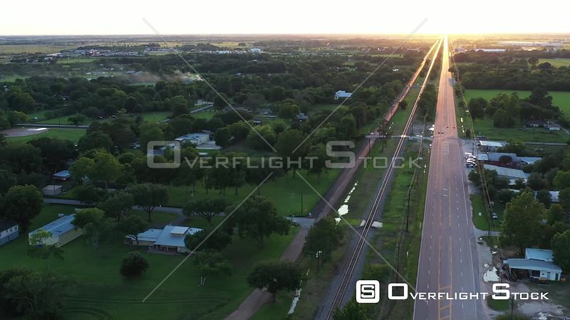 Sunset reflections on a Railroad through a Small Town, Hockley, Texas, USA