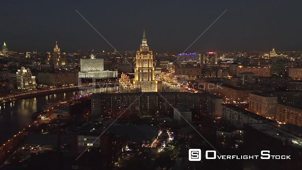 Nightflight Over Moscow Riverbank and Historical Building of Radisson Sas Hotel With City Lights. Moscow Russia Drone Video View
