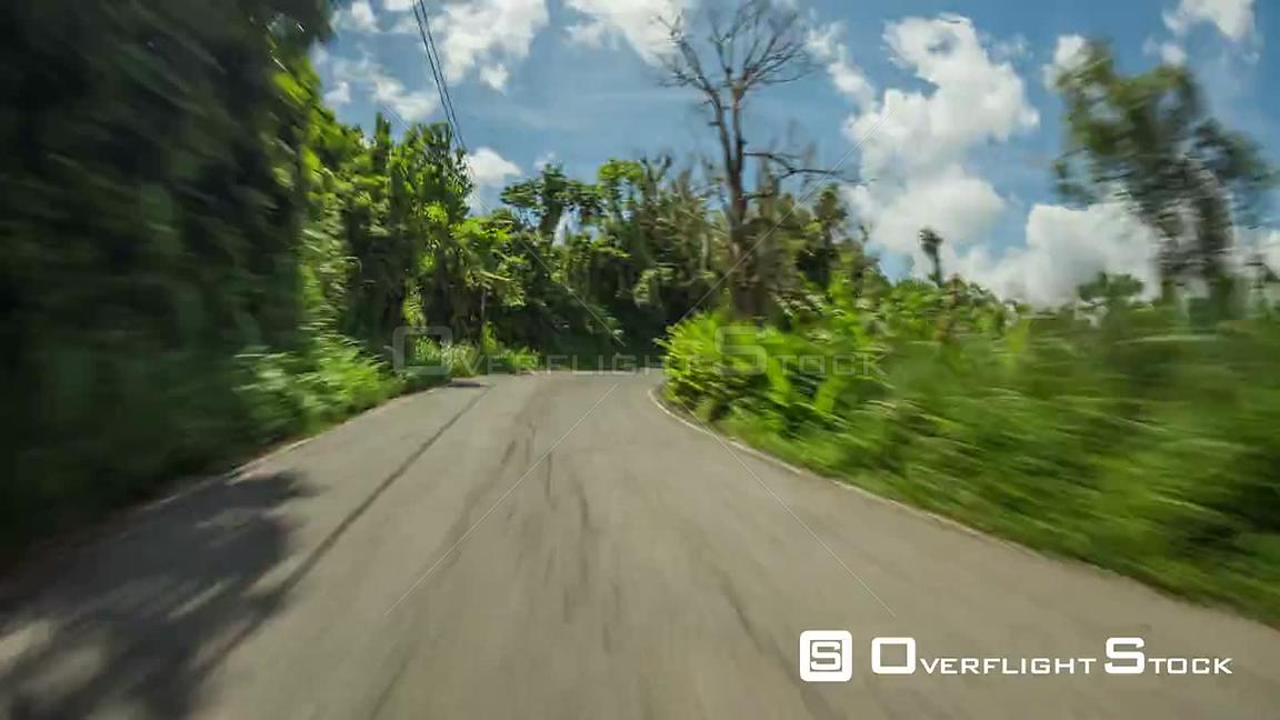 Driving time lapse through Puerto Rico jungle hills.