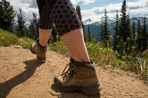 Close up of hiker's feet on hiking trail, Blackcomb Mountain, Whistler, Canada.