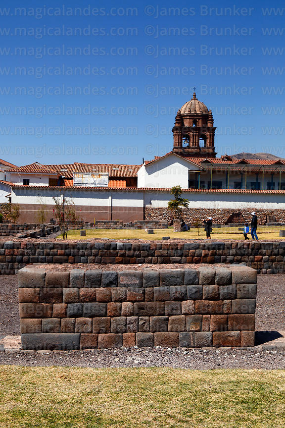 Inca ruins of Kusicancha, tower of Santo Domingo church in background, Cusco, Peru