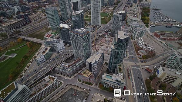 Toronto Ontario Birdseye detail over CityPlace construction panning out in reverse to full Niagara cityscape view
