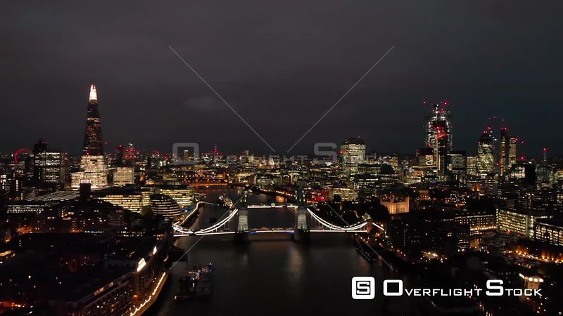 City of London Skyline and Tower Bridge, filmed by drone in autumn, at night, London, United Kingdom