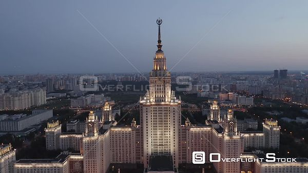 Dusk Moscow State University With City Lights Flight Backwards. Moscow Russia Drone Video View