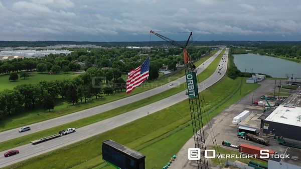 United States Flag suspended from a crane along an interstate highway, Dayton, Ohio, USA