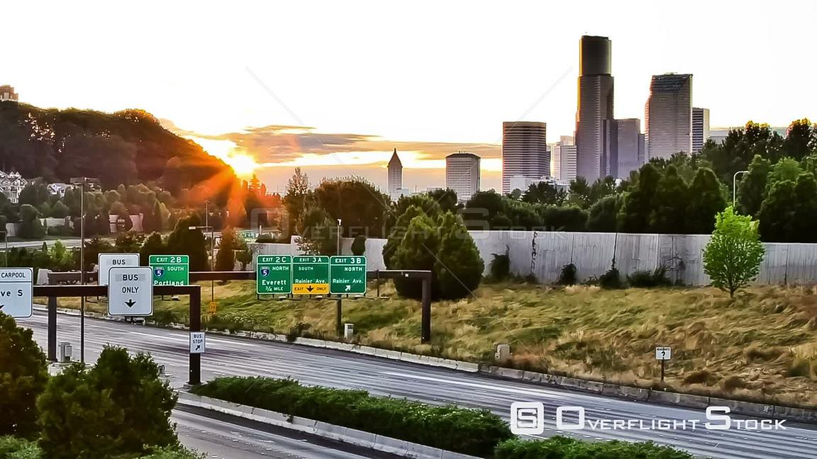 Seattle Washington State USA Zooming Seattle I90 traffic time lapse during sunset with cityscape in background.